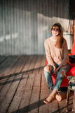 Young modern girl on veranda. sunset evening in the village . Stock Photos
