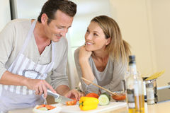 Young and modern good looking couple cooking together Stock Photography