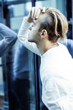 Young modern hipster guy at new building university blond fashion hairstyle having fun, lifestyle people concept. Close up stock images