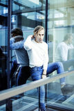 Young modern hipster guy at new building university blond fashion hairstyle having fun, lifestyle people concept. Close up royalty free stock photos