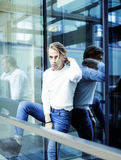 Young modern hipster guy at new building university blond fashion hairstyle having fun, lifestyle people concept. Close up stock photography