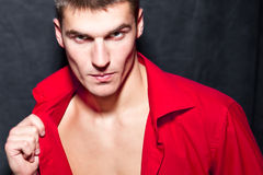 Young Modern Macho Man In Red Shirt Is Posing Stock Photography