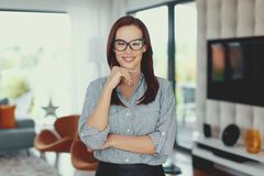 Young modern nerd woman posing indoors royalty free stock photography