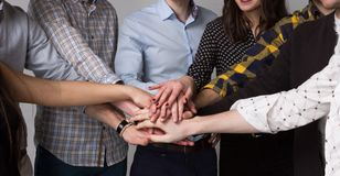 Young Modern People Melded Their Hands in the Sign of Power. Connected Hands of Modern Young People. Team Concept Royalty Free Stock Image