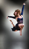 Young modern style dancer jumping in studio. Stylish and young modern style dancer jumping in studio royalty free stock image