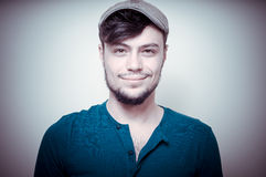 Young modern stylish man with cap Royalty Free Stock Images