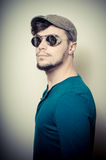 Young modern stylish man with cap Royalty Free Stock Photo
