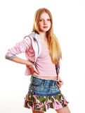 Young modern teenage girl. In stylish clothes of the time. White background Royalty Free Stock Photo
