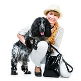 Young modern woman with her dog cocker spaniel Royalty Free Stock Photo