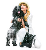 Young modern woman with her dog cocker spaniel Royalty Free Stock Photos