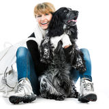 Young modern woman with her dog cocker spaniel Royalty Free Stock Images