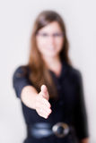 Young Modern Woman Holding Hand Out To Shake. Royalty Free Stock Photography