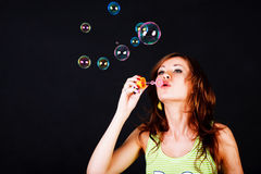 Young modest beautiful girl lets soap balls Stock Photo