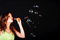 Young modest beautiful girl lets soap balls Royalty Free Stock Photo