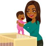 Young Mom Baby Crib Stock Image