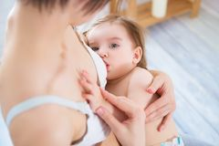 Free Young Mom Breast Feeding Her Newborn Child. Royalty Free Stock Photography - 138880797