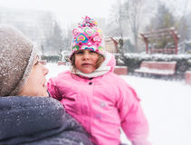 Young mom and daughter in winter Royalty Free Stock Image