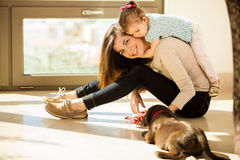 Young mom with her babies Stock Images
