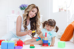 Young mom with her child play together Stock Image