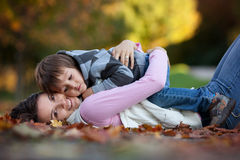 Young mom with her little boy in the park Royalty Free Stock Photography