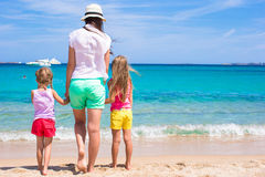 Young mom and little girls at white beach on sunny Royalty Free Stock Photography