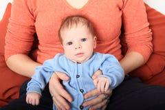 Mom holding newborn baby girl Stock Photo
