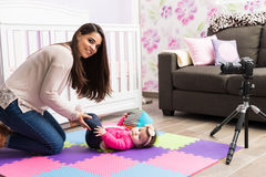 Young mom recording a video for blog Stock Image
