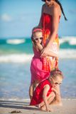 Young Mom and two adorable daughters walking at Stock Image