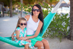 Young mommy and little girl on tropical vacation Stock Images