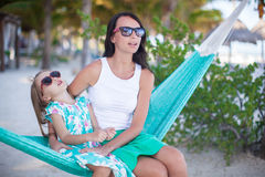 Young mommy and little girl on tropical vacation Stock Image