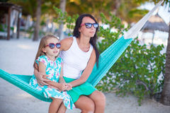 Young mommy and little girl on tropical vacation Royalty Free Stock Image