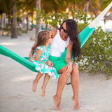 Young mommy and little girl on tropical vacation Royalty Free Stock Photo
