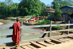 Young monk. On wooden bridge Royalty Free Stock Photos