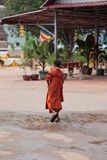 Young monk, Angkor Wat, Cambodia. Young monk in robes walking outdoors at Angkor Wat in Siem Reap, Cambodia Stock Photography