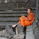 Young monk at Angkor Wat. Young monk in orange robes at Angkor Wat in Cambodia royalty free stock photo