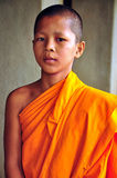 A young monk at Angkor wat temple Royalty Free Stock Photo