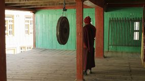 Young monk beats in big gong in nepalese village Lho, Nepal. Young monk beats in big gong in nepalese village Lho, Nepal stock video