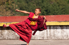 Young monk in exercise Royalty Free Stock Image