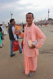 Young monk holding holy book Bhagvat Geeta Royalty Free Stock Photography