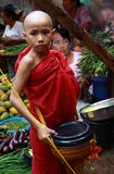 Young monk in a market in Myanmar Royalty Free Stock Photo