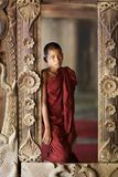 Young Monk Myanmar Burma. OLD BAGAN, MYANMAR- OCT 14: An unidentified young novice monk standing in window in Old Bagan, Myanmar on October 14, 2011 royalty free stock images