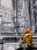 Young monk with pensive expression Royalty Free Stock Image