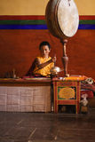 Young monk performing puja Stock Photo