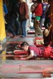 Young monk praying Stock Image