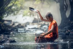 Young monk at river