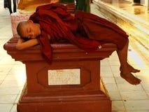 Young monk sleeping at Shwedagon Pagoda, Yangon, Myanmar Royalty Free Stock Photos