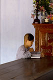 Young monk studying at a temple. In Vietnam Royalty Free Stock Photos