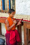Young monk at work at the school of the Buddhist religion near C royalty free stock photo