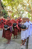 Young Monks Begging for Alms Royalty Free Stock Photography