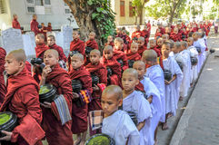 Young Monks Begging for Alms. Amarapura Stock Image